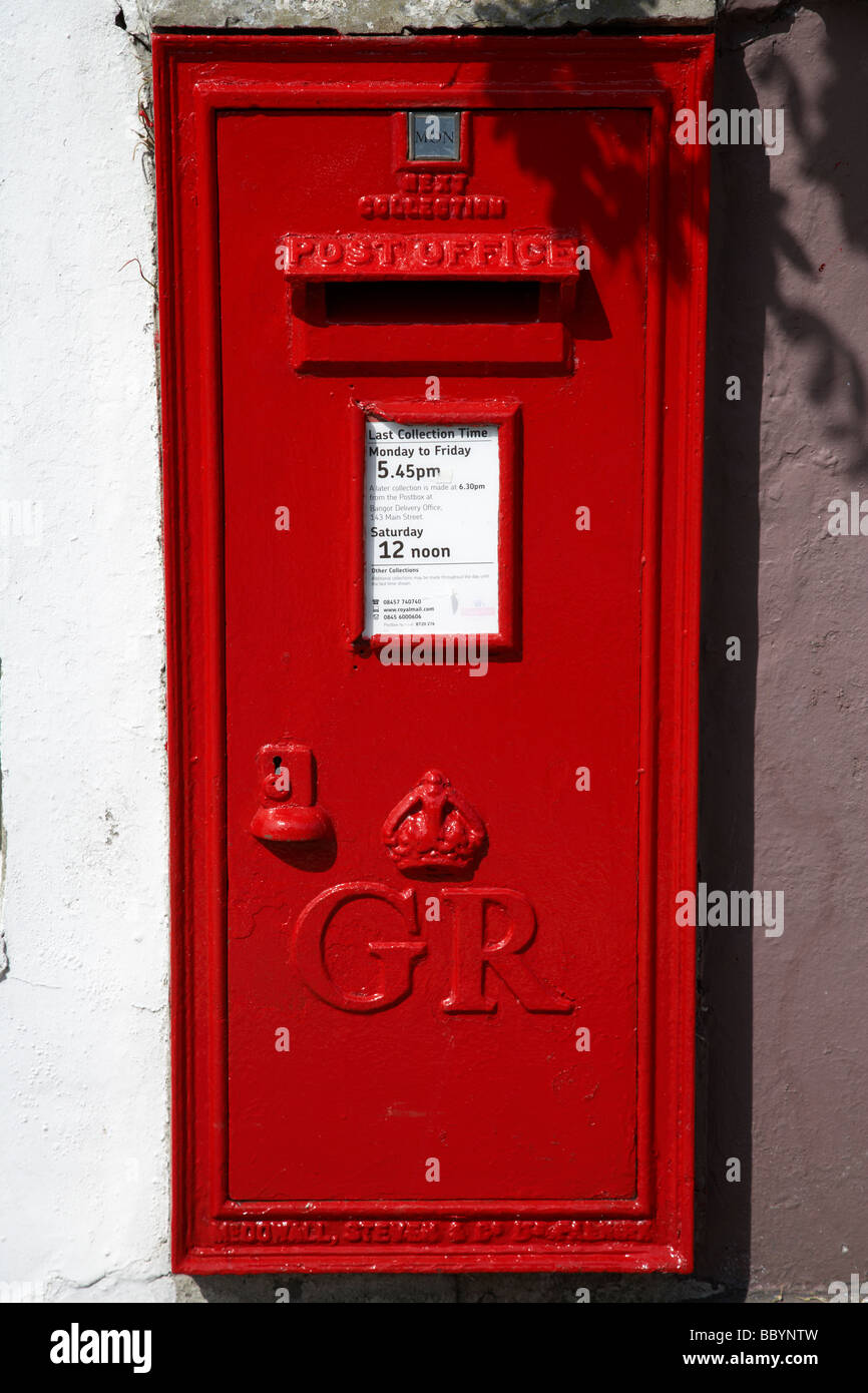 freshly painted red GR post office mail collection wallbox in bangor county down northern ireland uk Stock Photo