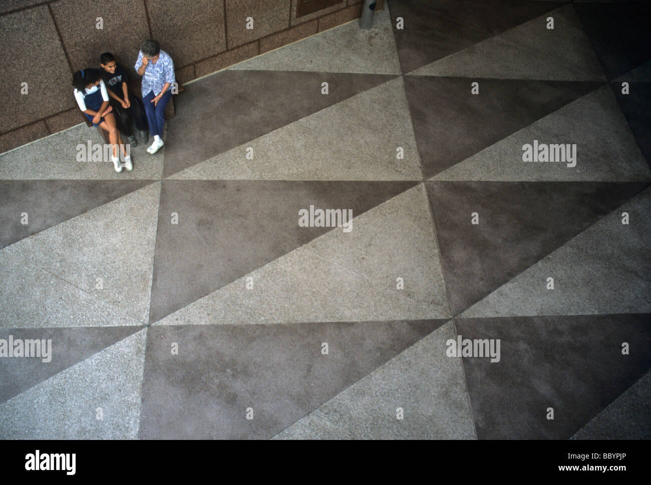 Triangle math geometry floor terrazo tile pattern shape people sit ...