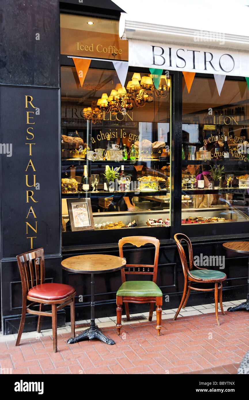 Empty chairs outside trendy cafe Central Dublin Republic of Ireland - Stock Image