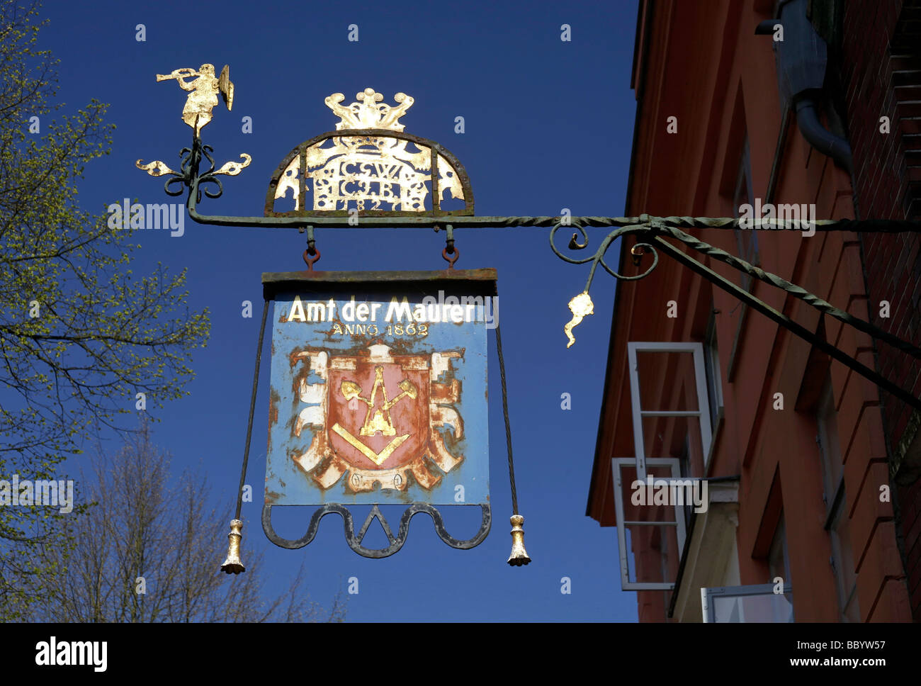 Craftsman advertising panel reading Amt der Maurer on a building in the historic town, Moelln, Holstein, Schleswig - Stock Image