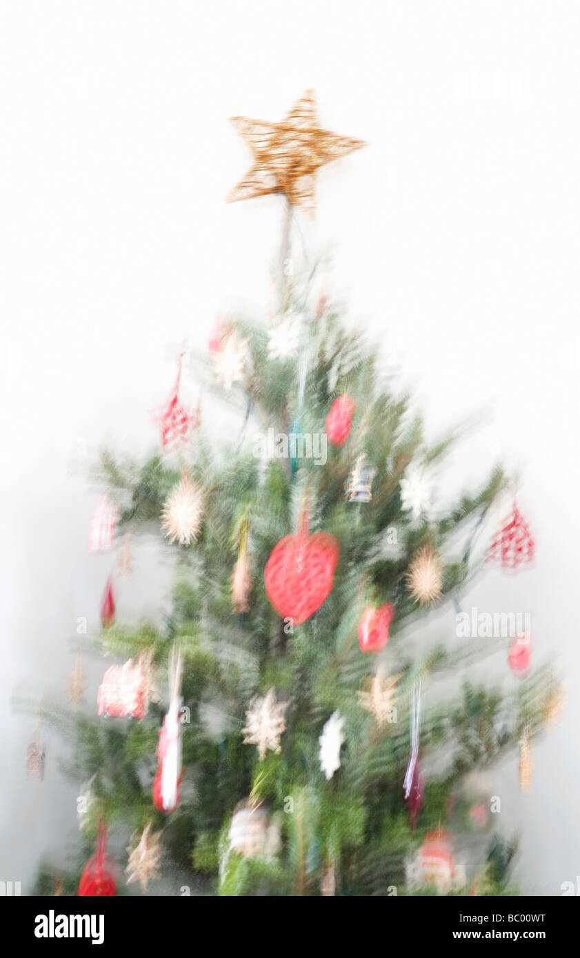 Blurred image of decorated Christmas tree - Stock Image