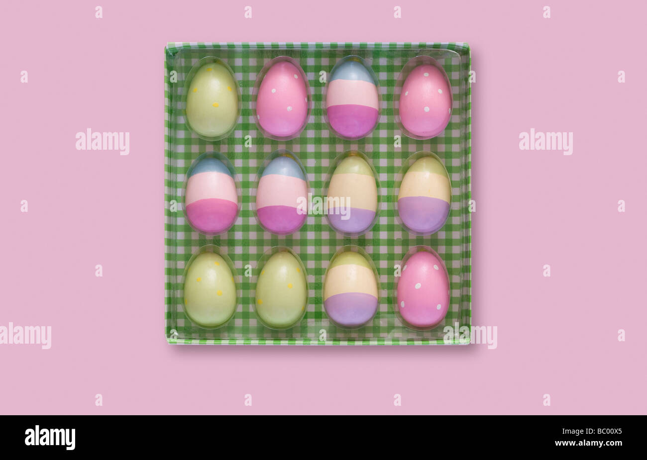 Box of colourful painted Easter eggs - Stock Image