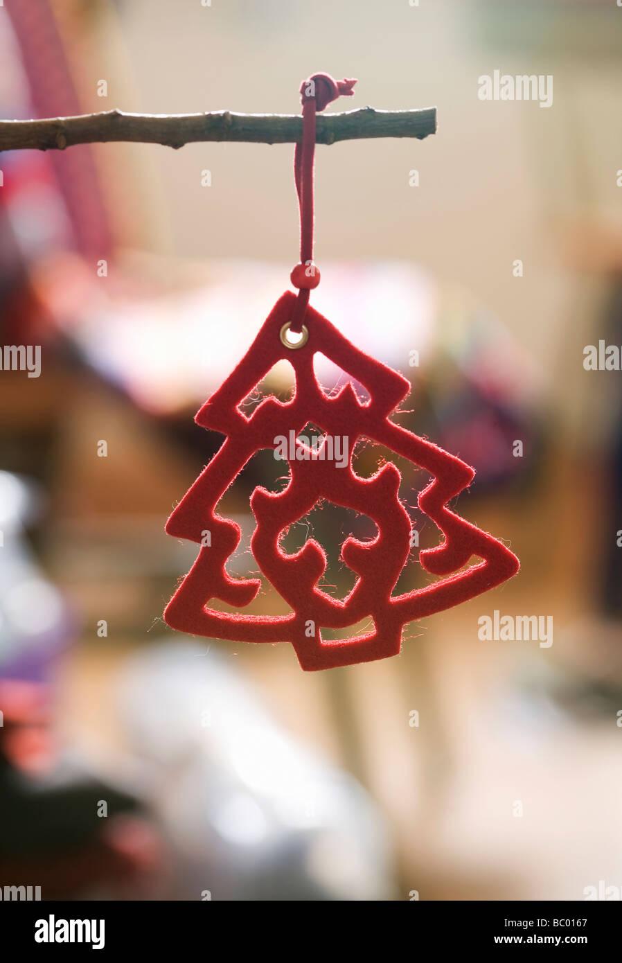 Red Christmas tree decoration - Stock Image