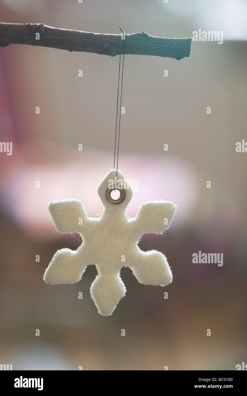 Snowflake Christmas tree decoration - Stock Image