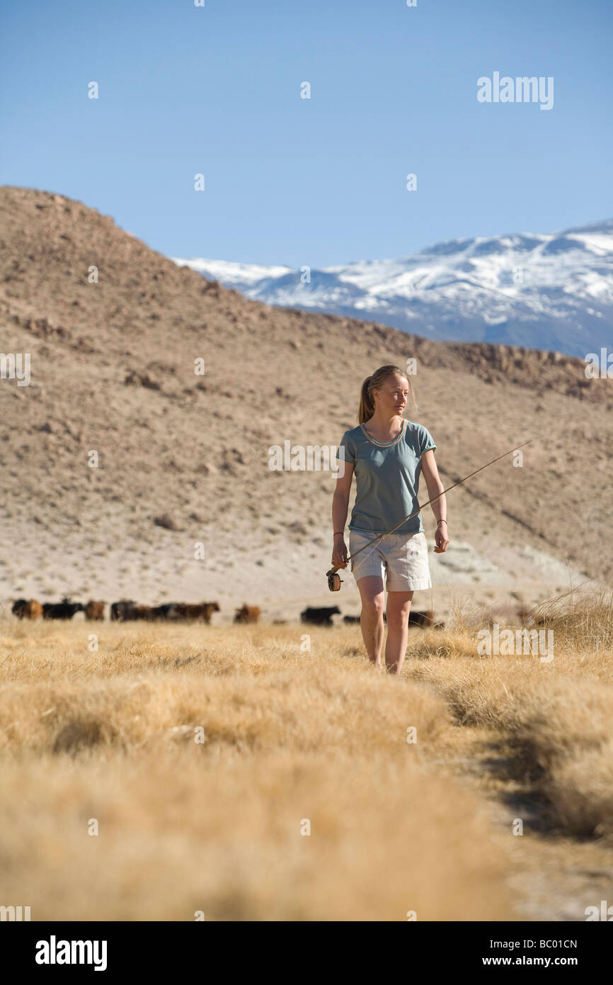 Young woman returning from fly fishing in Bishop, CA. - Stock Image
