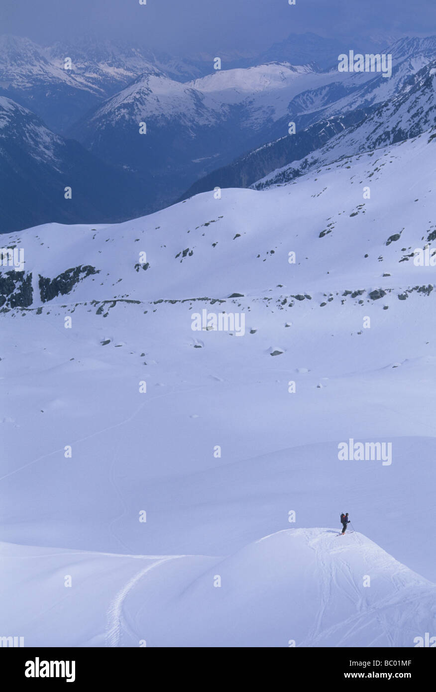 Skiing down Mt. Blanc after successful summit of Western Europe's tallest peak. - Stock Image