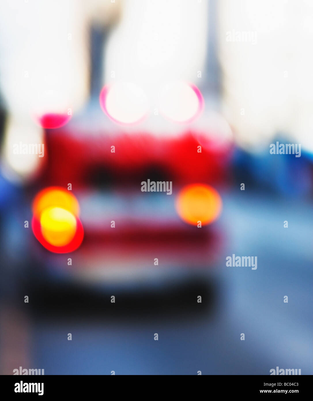 abstracted ambulance parked on street - Stock Image