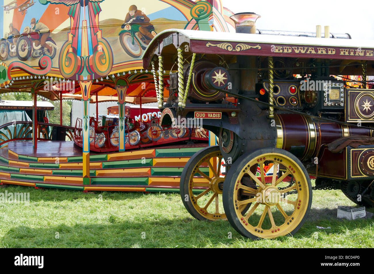 Burrell showman's engine and traditional fairground ride at a country fair in Hampshire, England - Stock Image