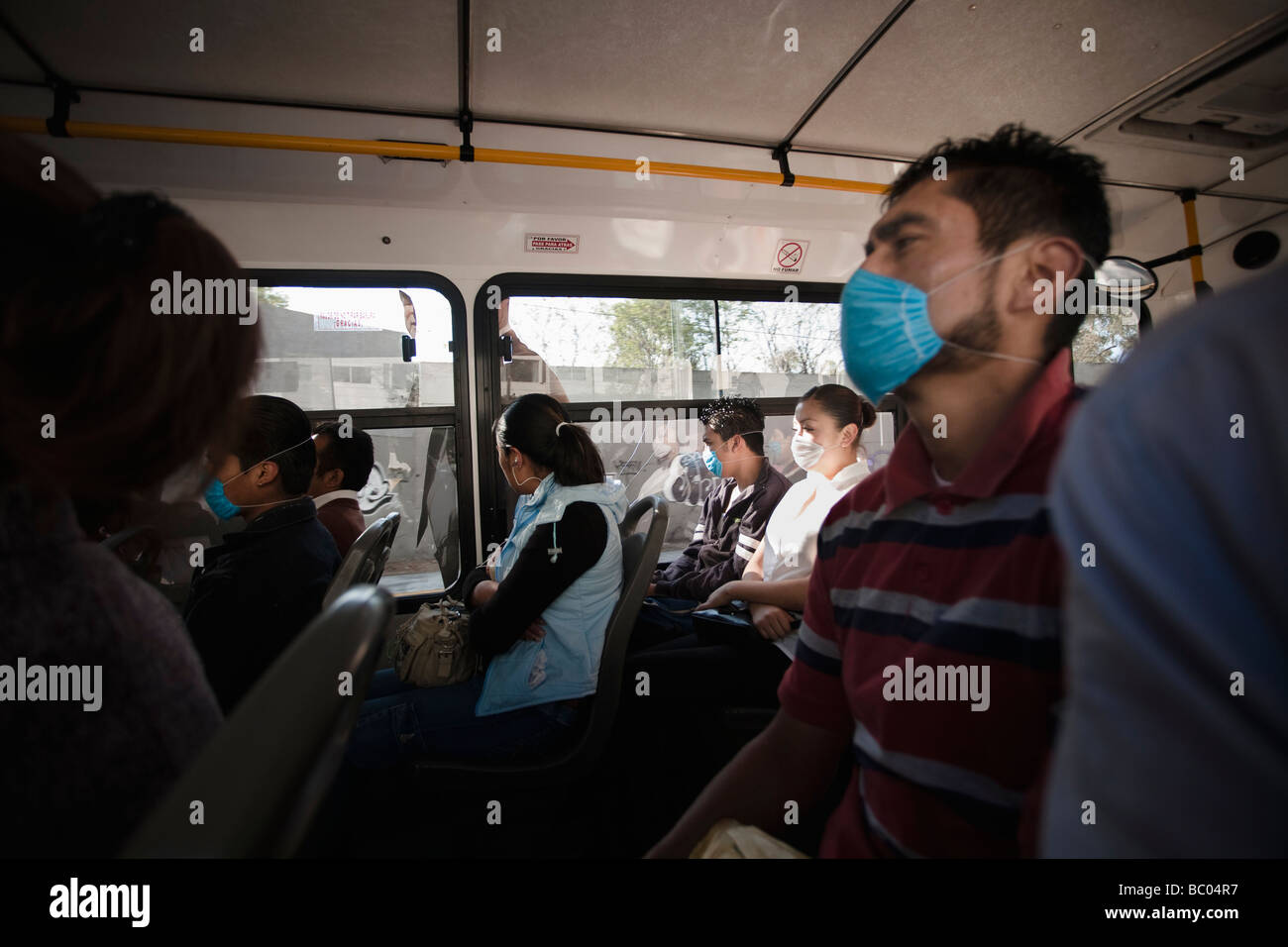 People inside a bus wearing masks during the swine flu epidemic in Mexico City, DF, Mexico. - Stock Image