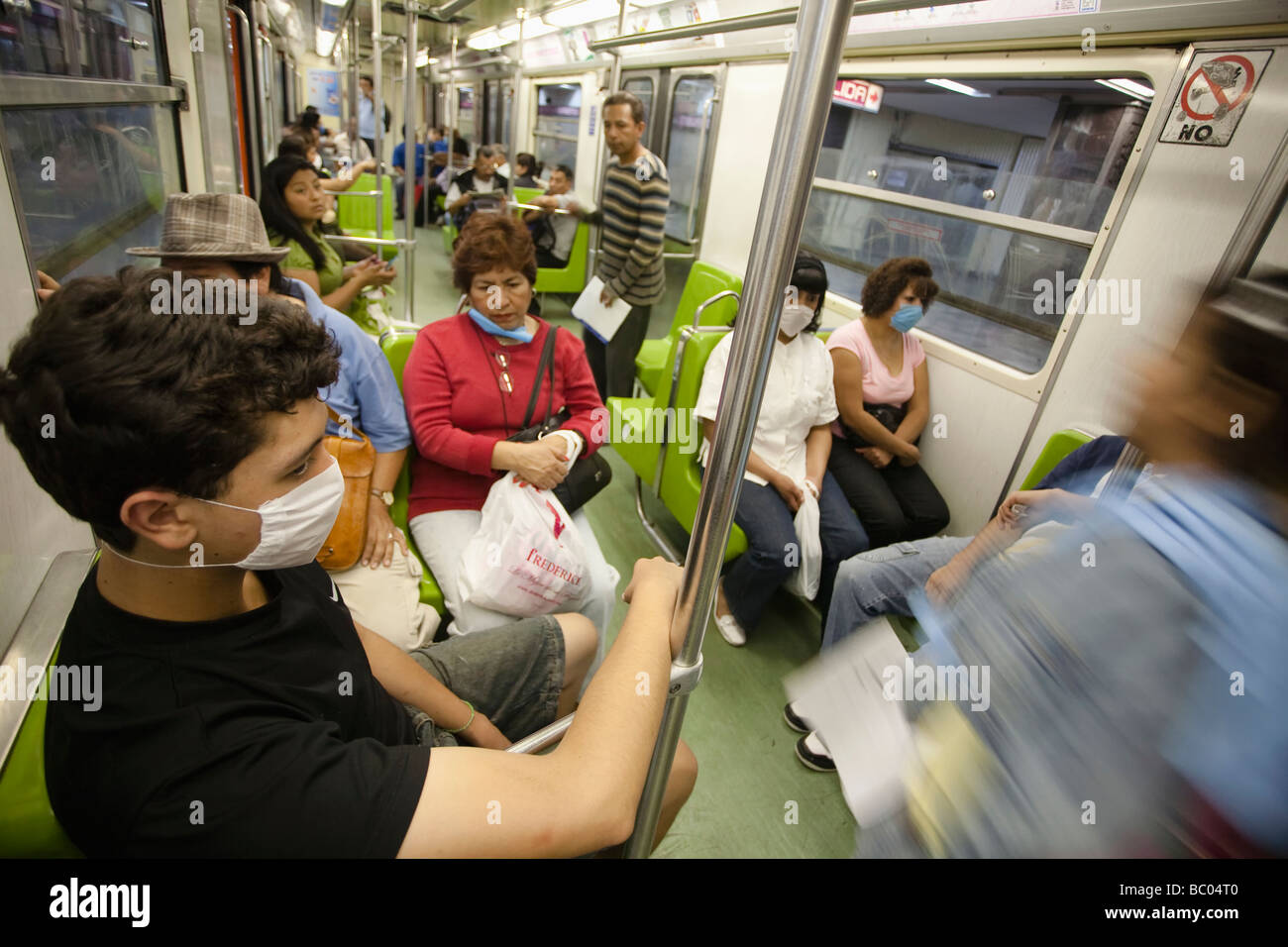People inside the metro wearing masks as protection during the swine flu epidemic in Mexico City, DF, Mexico. - Stock Image