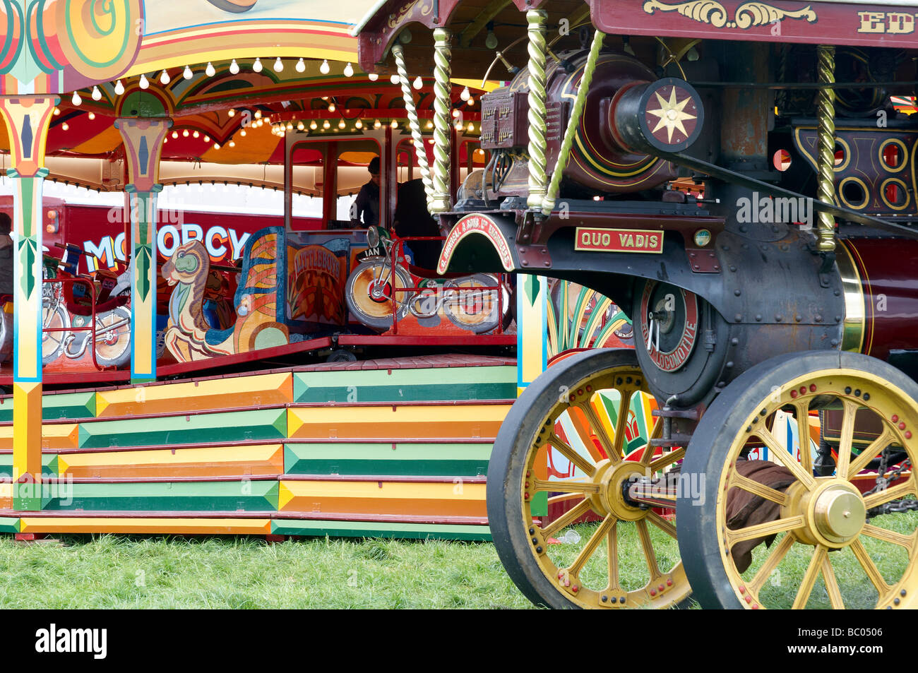 Traditional fairground ride and Burrel Showmans engine. - Stock Image