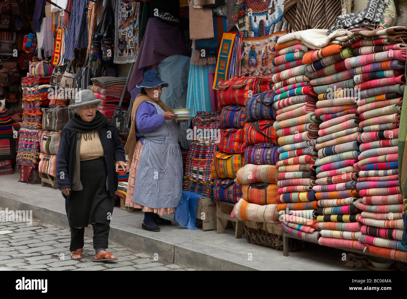 Painet jq3399 bolivia shop selling ponchos weavings la paz america south latin indigenous native economy trade street - Stock Image