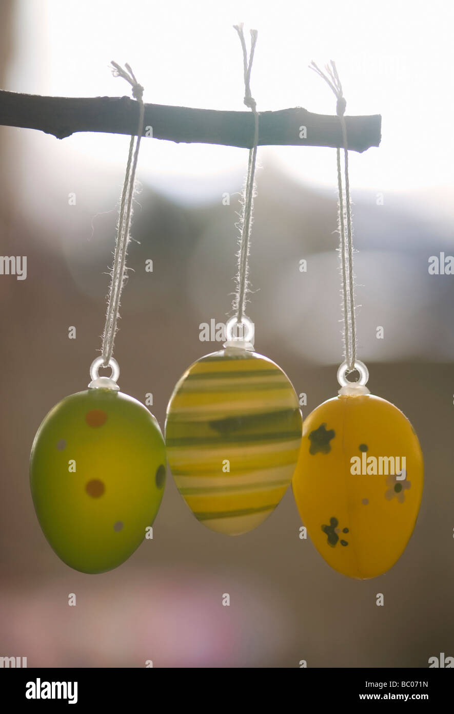 Three painted Easter eggs hanging from a twig - Stock Image