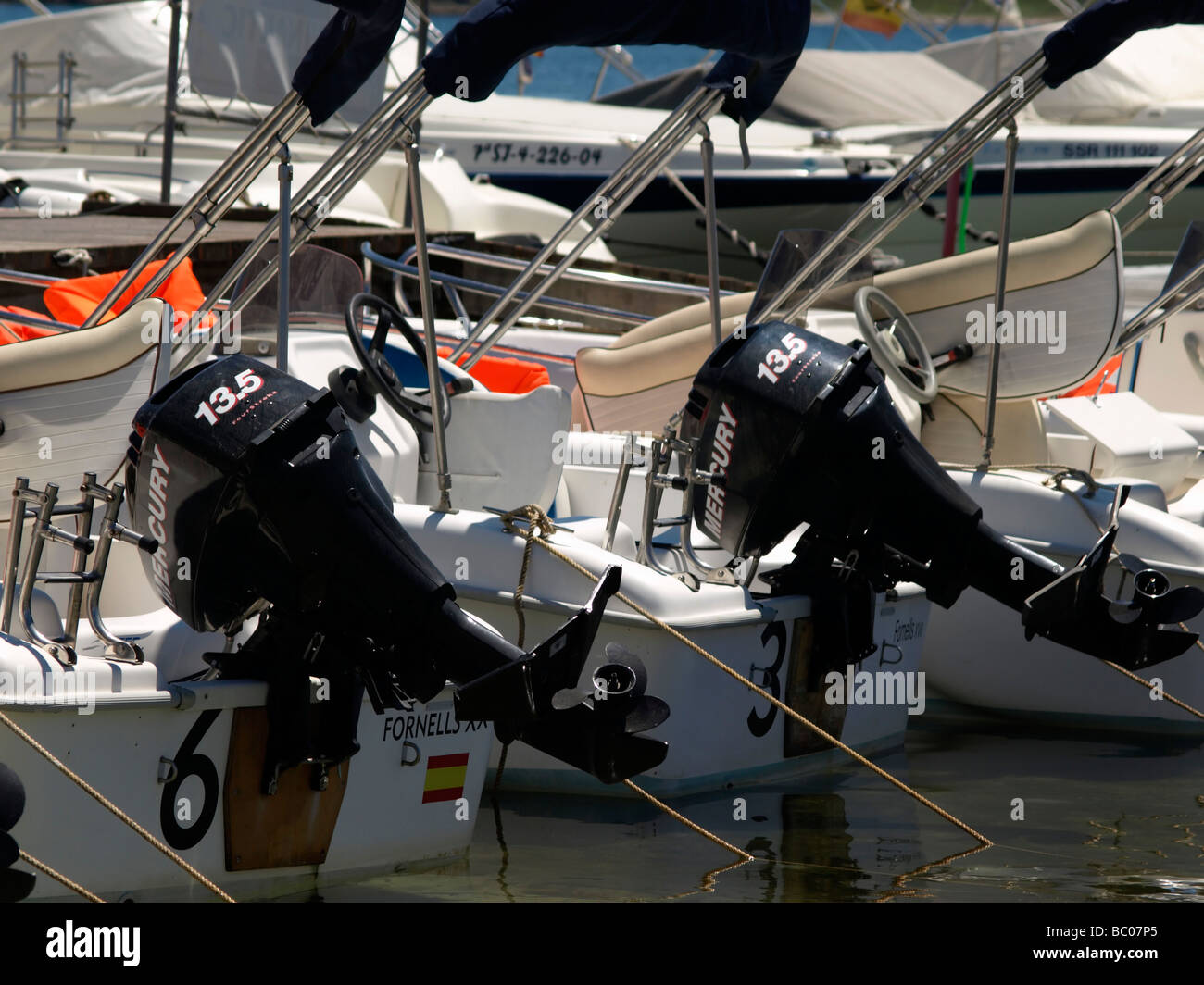 Two 13.5 HP Mercury outboard motors. - Stock Image