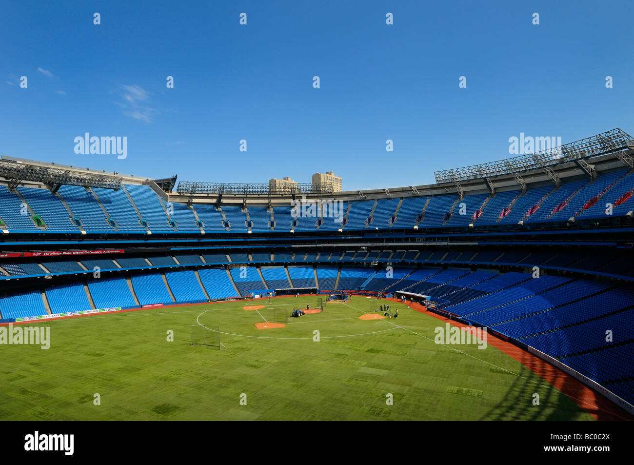 Toronto Rogers Centre SkyDome green field and empty stadium seats with roof open preparing for a baseball game - Stock Image