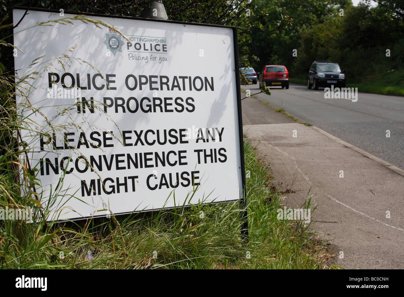 Police Operation In Progress. A Nottinghamshire Police roadside sign. - Stock Image
