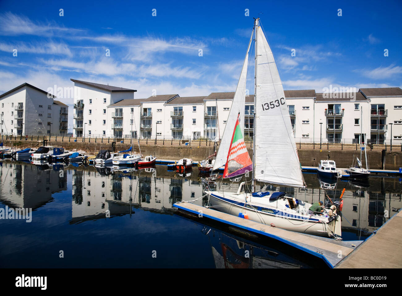 A yacht moored in Ardrossan harbour, North Ayrshire, Scotland. - Stock Image