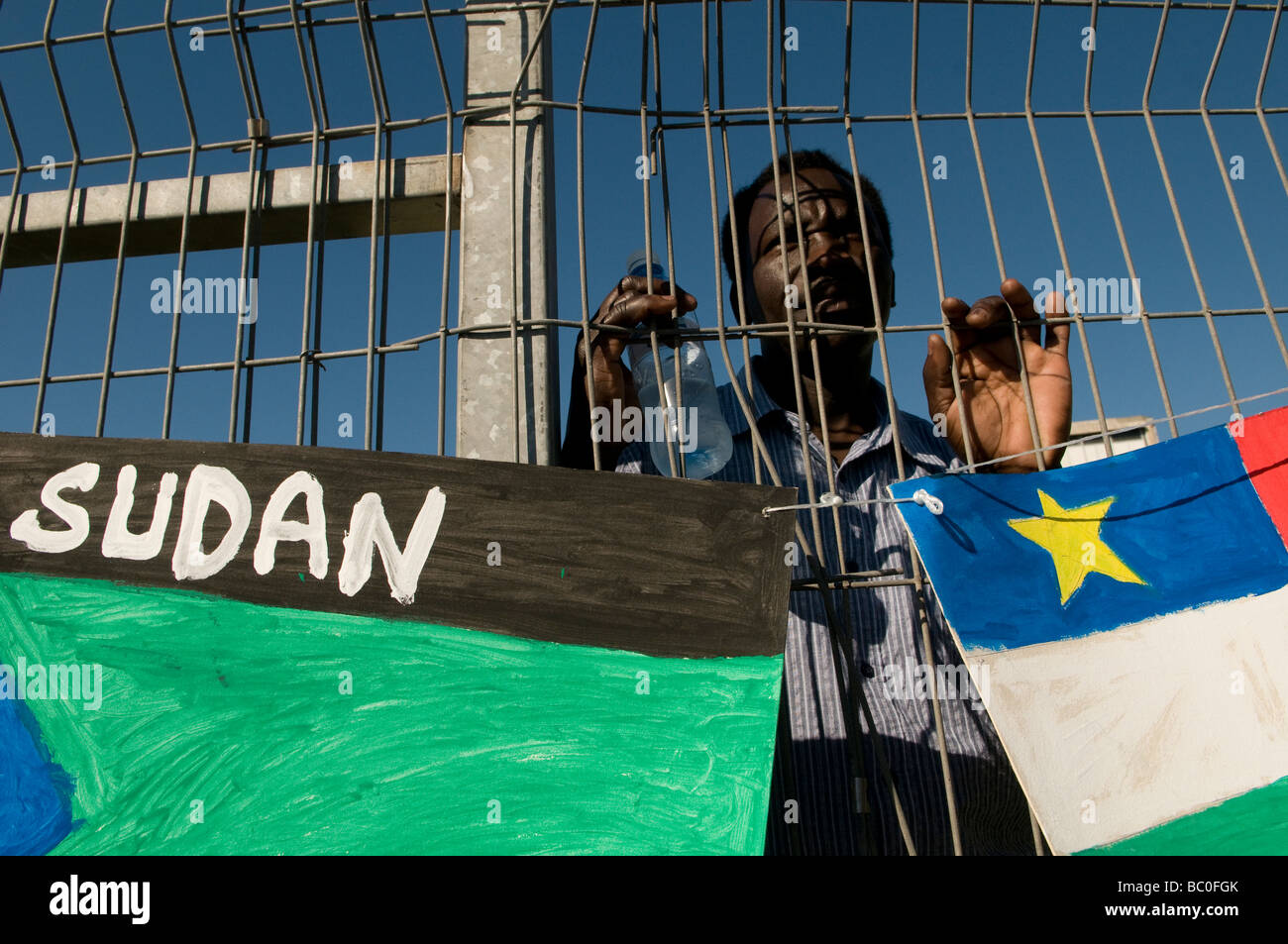 African migrant with African flags during UNHCR Refugee day event in Tel Aviv Israel - Stock Image