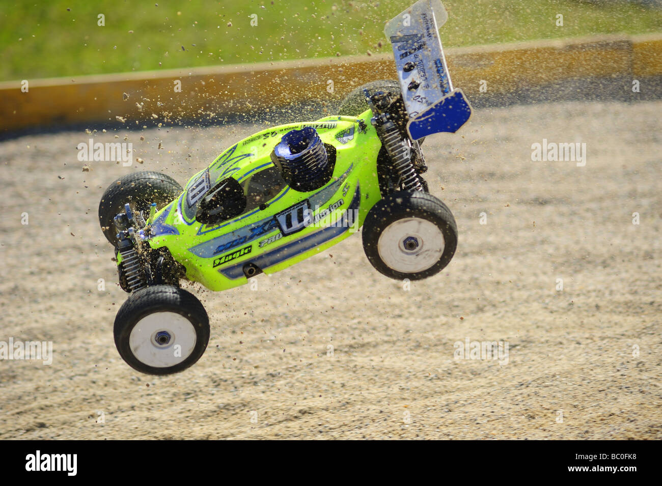Action shot of a radio-controlled buggy racing in the European Championships. Motion blur shows the speed it's travelling. - Stock Image