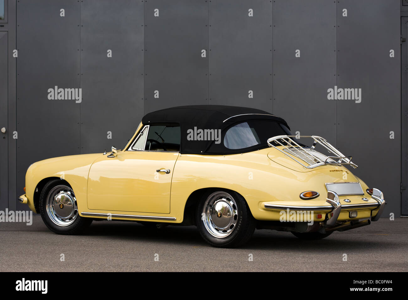 vintage yellow Porsche 356 convertible in excellent condition - Stock Image