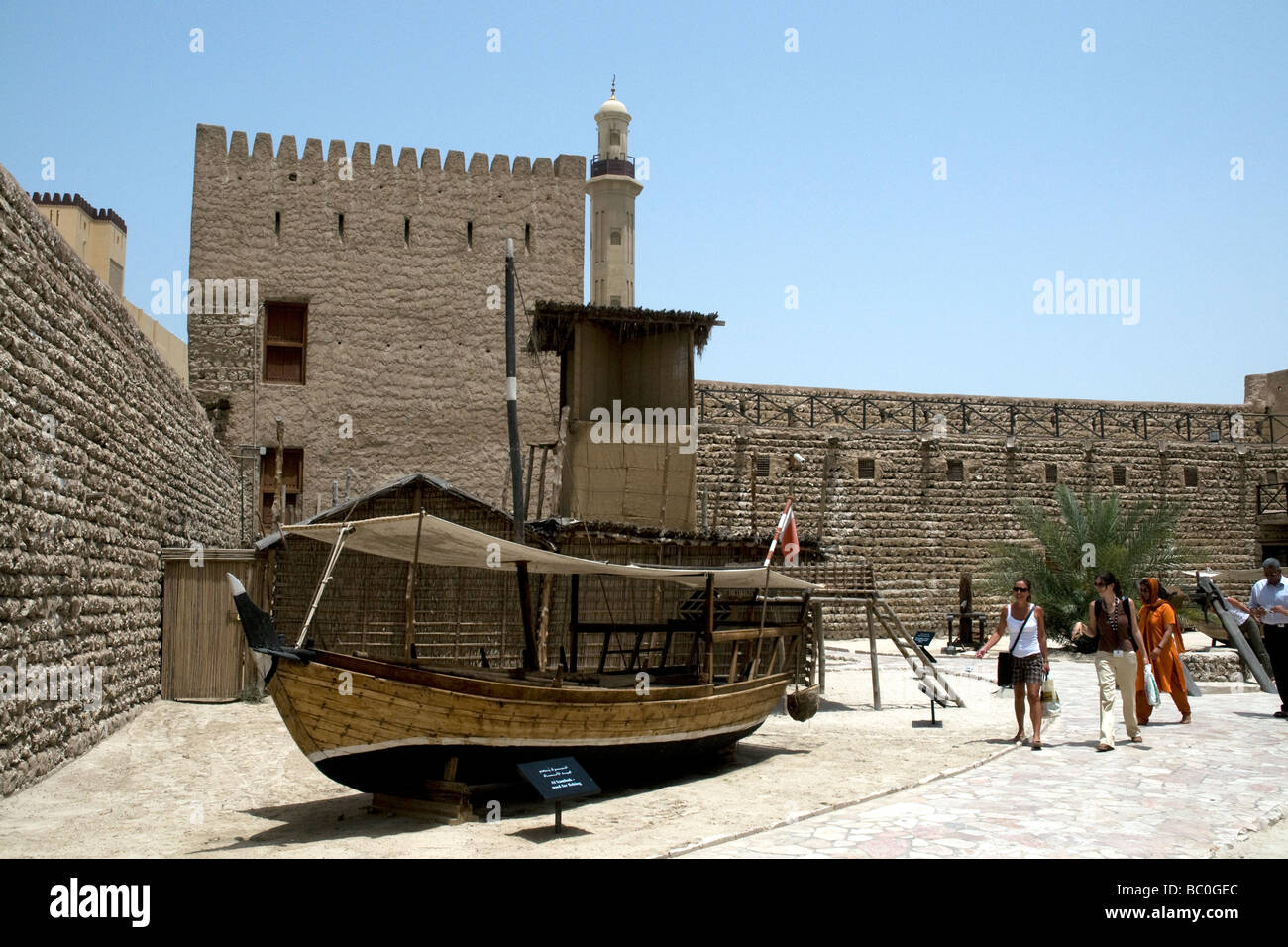 A classic Arab dhow, a small sambuk, is the centrepiece of the Dubai Museum courtyard - Stock Image