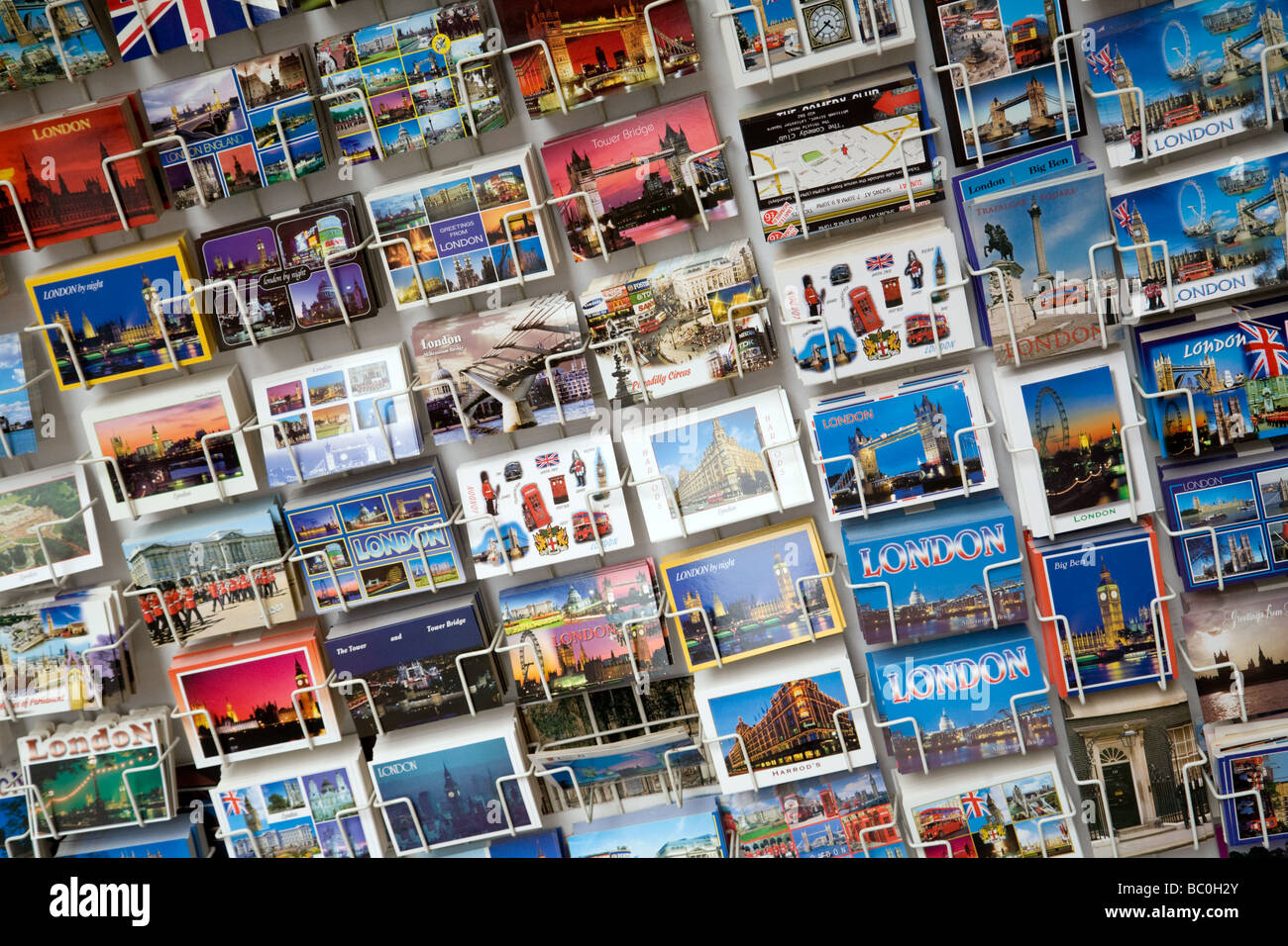 Postcards for sale in a stall in the west end of London, UK - Stock Image
