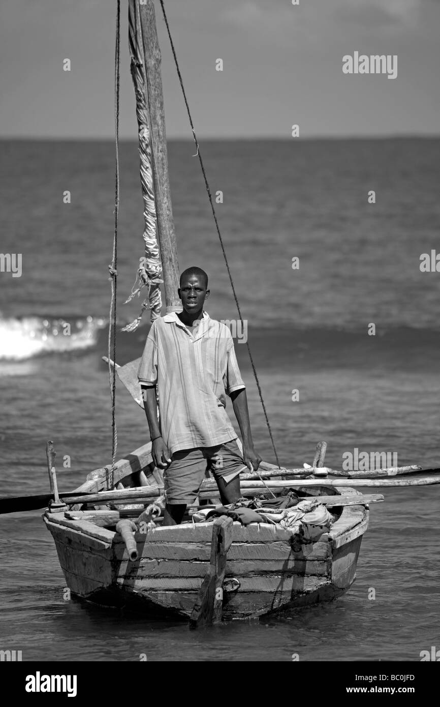 Haiti, Nord, Cap Haitien. Local fisherman and boat, Cormier Plage. - Stock Image