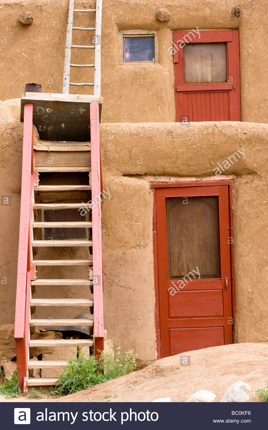 Red Doors and Ladders Taos Pueblo New Mexico - Stock Image