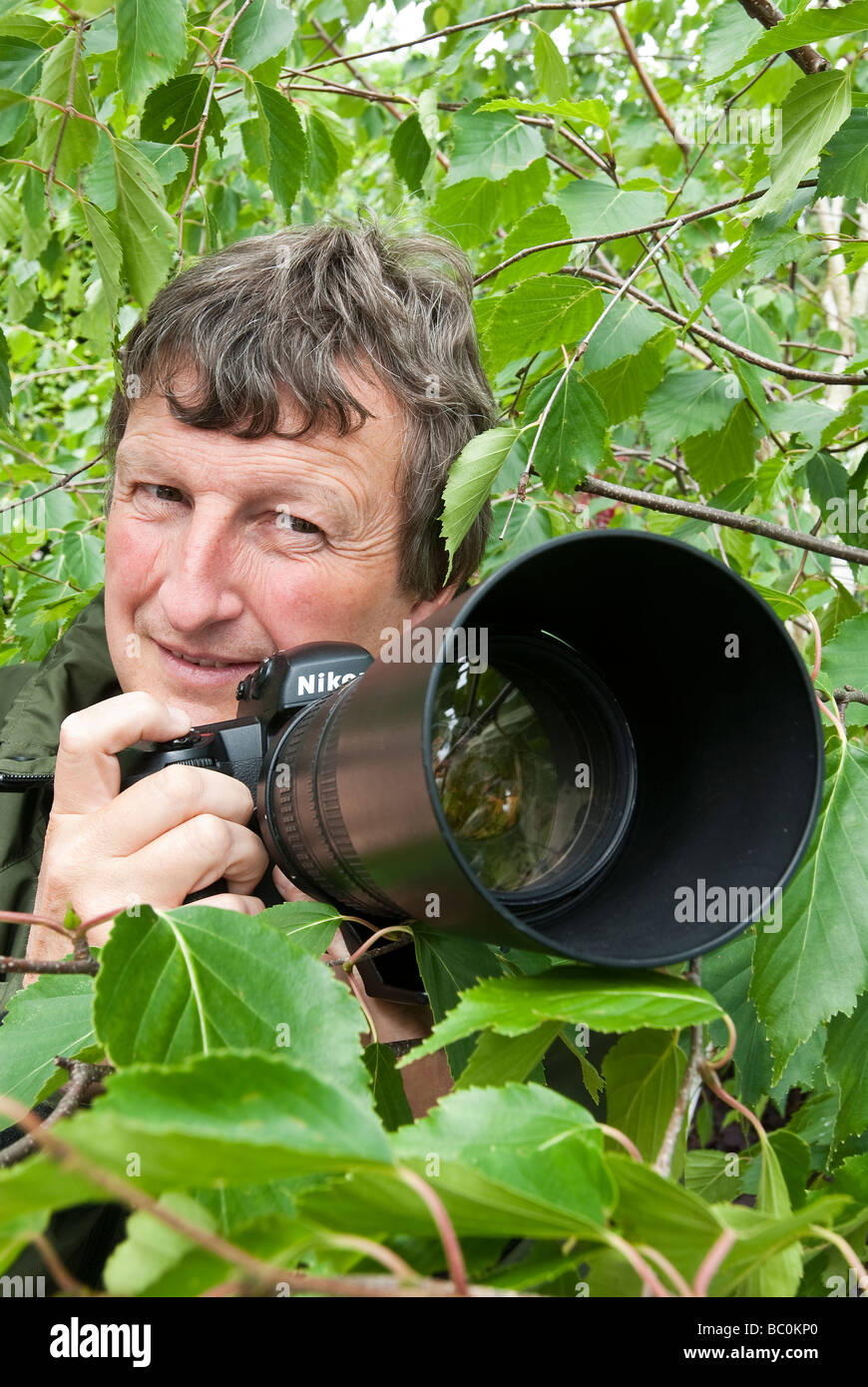 A wildlife photographer. - Stock Image