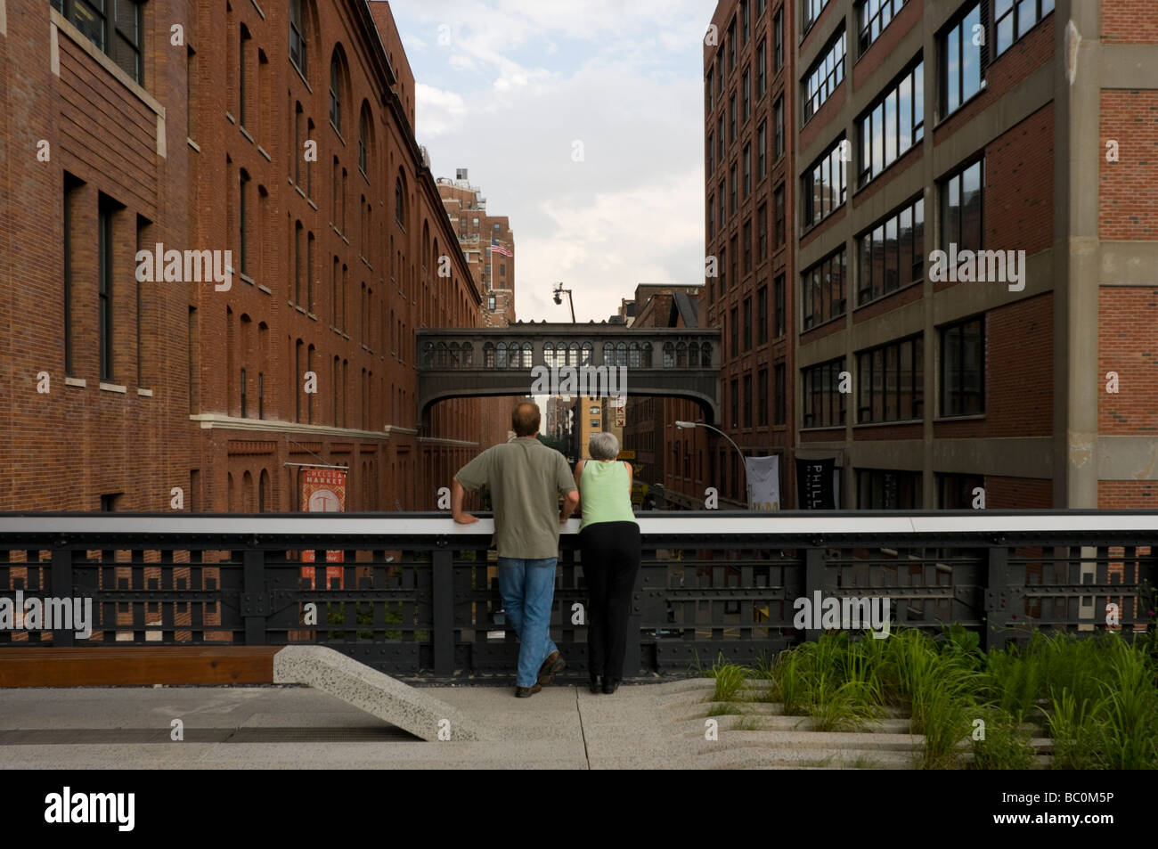 Visitors looking east from the High Line Park - Stock Image