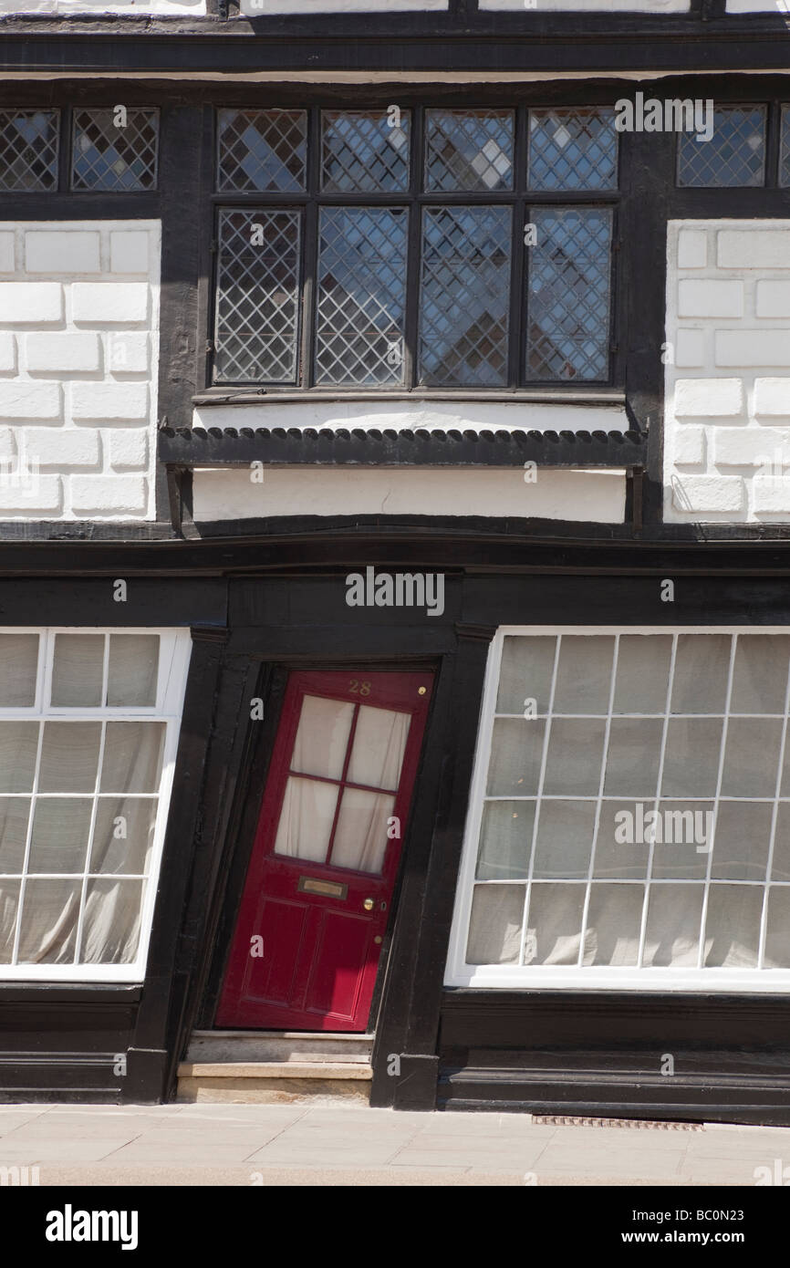Quaint crooked house front door in historic medieval timber framed wonky building. Canterbury Kent England UK Britain - Stock Image