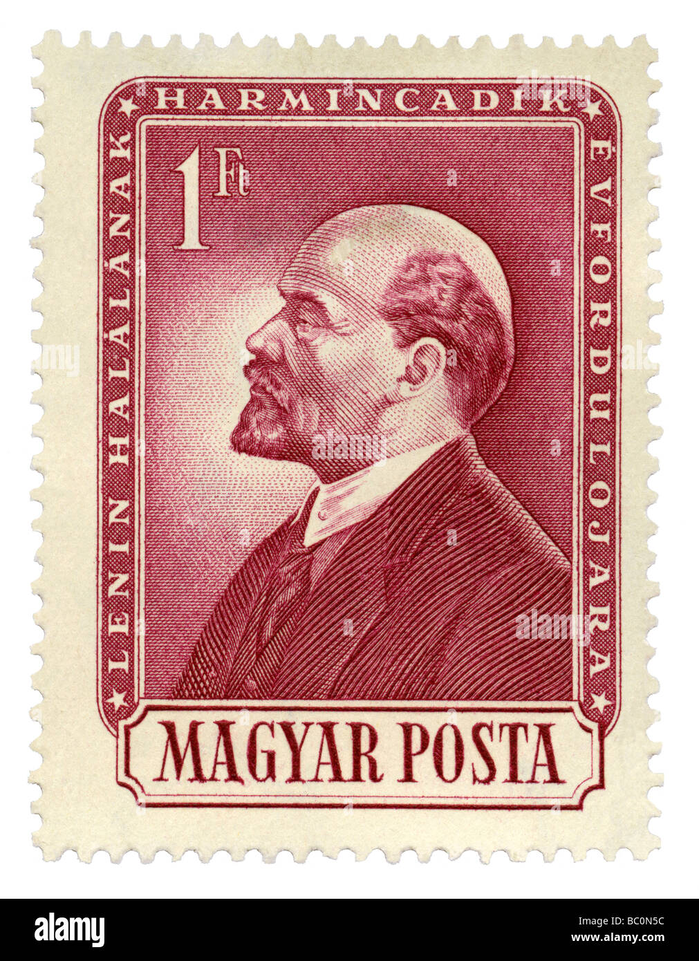 Old Hungarian postage stamp with portrait of Lenin - Stock Image