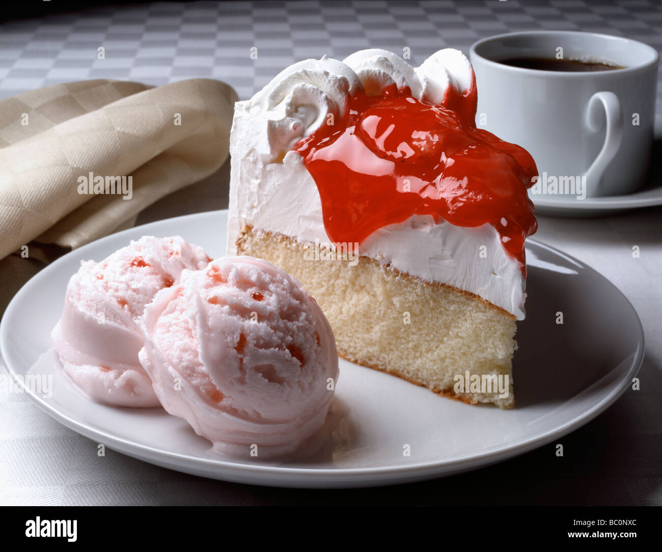 Strawberry topped white cake on a plate with strawberry ice cream and a cup of black coffee. & Strawberry topped white cake on a plate with strawberry ice cream ...