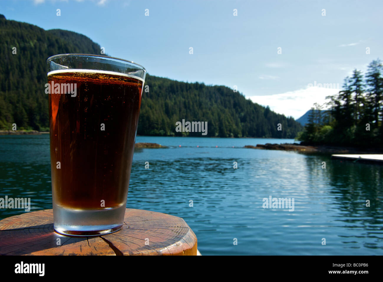Heaven is a pint of ice cold beer in a chilled glass on a hot sunny day at a wilderness fishing resort Haida Gwaii - Stock Image