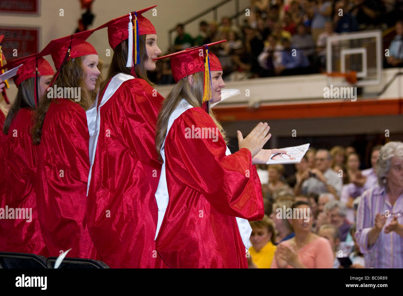 Graduation ceremony, female high school students in cap and gown ...
