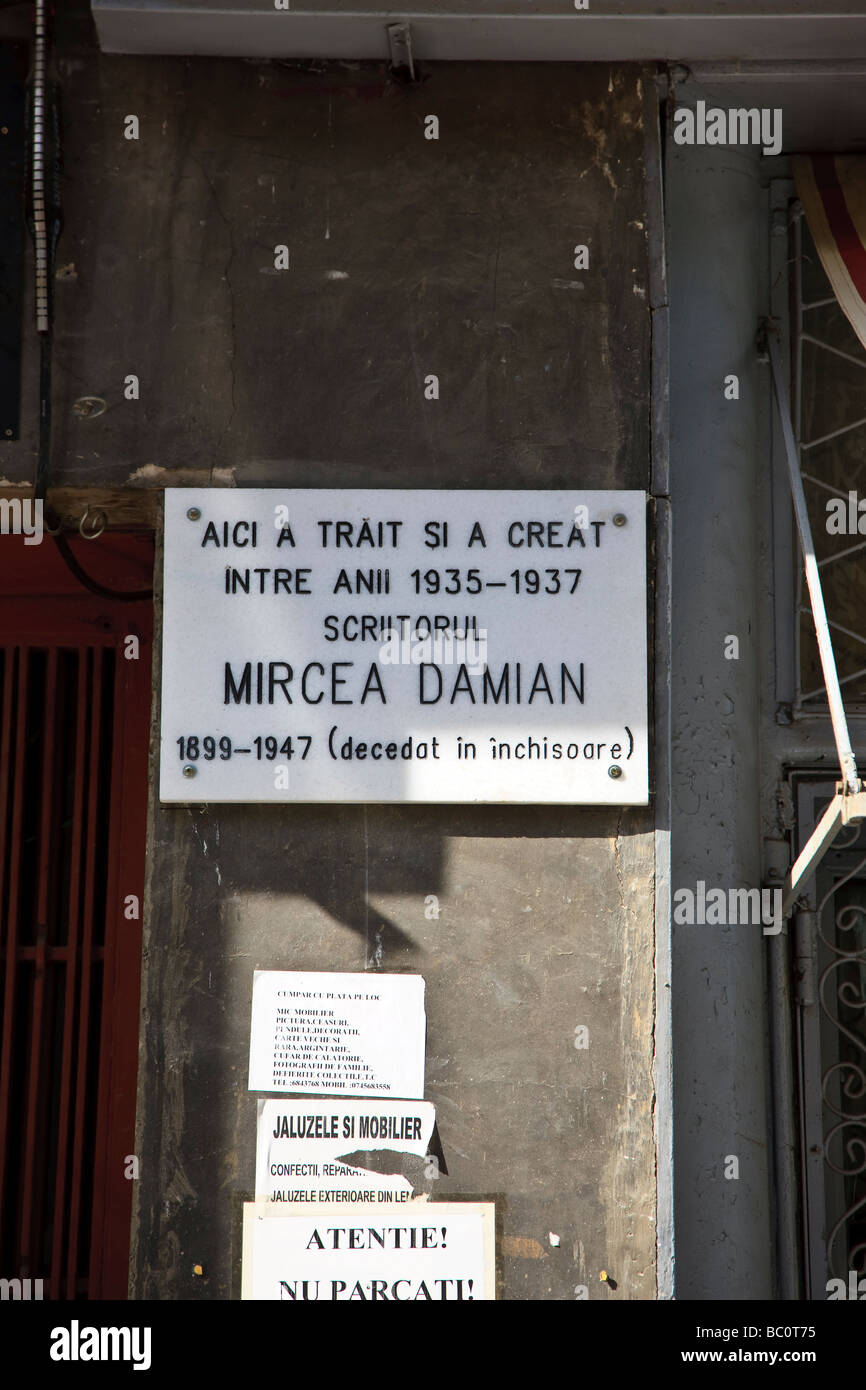 Memorial plaque on a residence in Bucharest Romania of romanian writer Mircea Damian victim of communist imprisonment - Stock Image