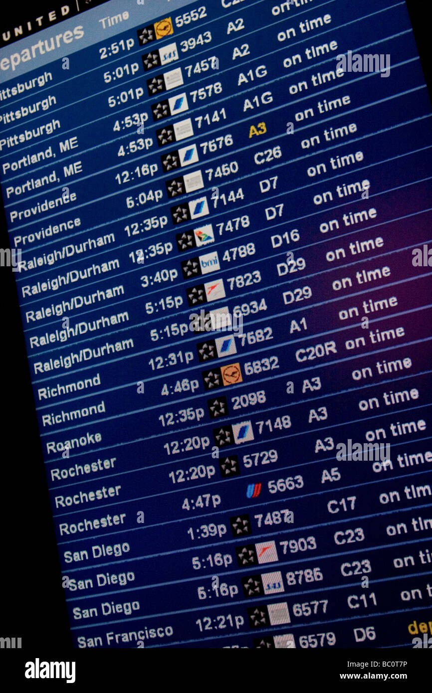 Close-up of of departure board in airport terminal - Stock Image
