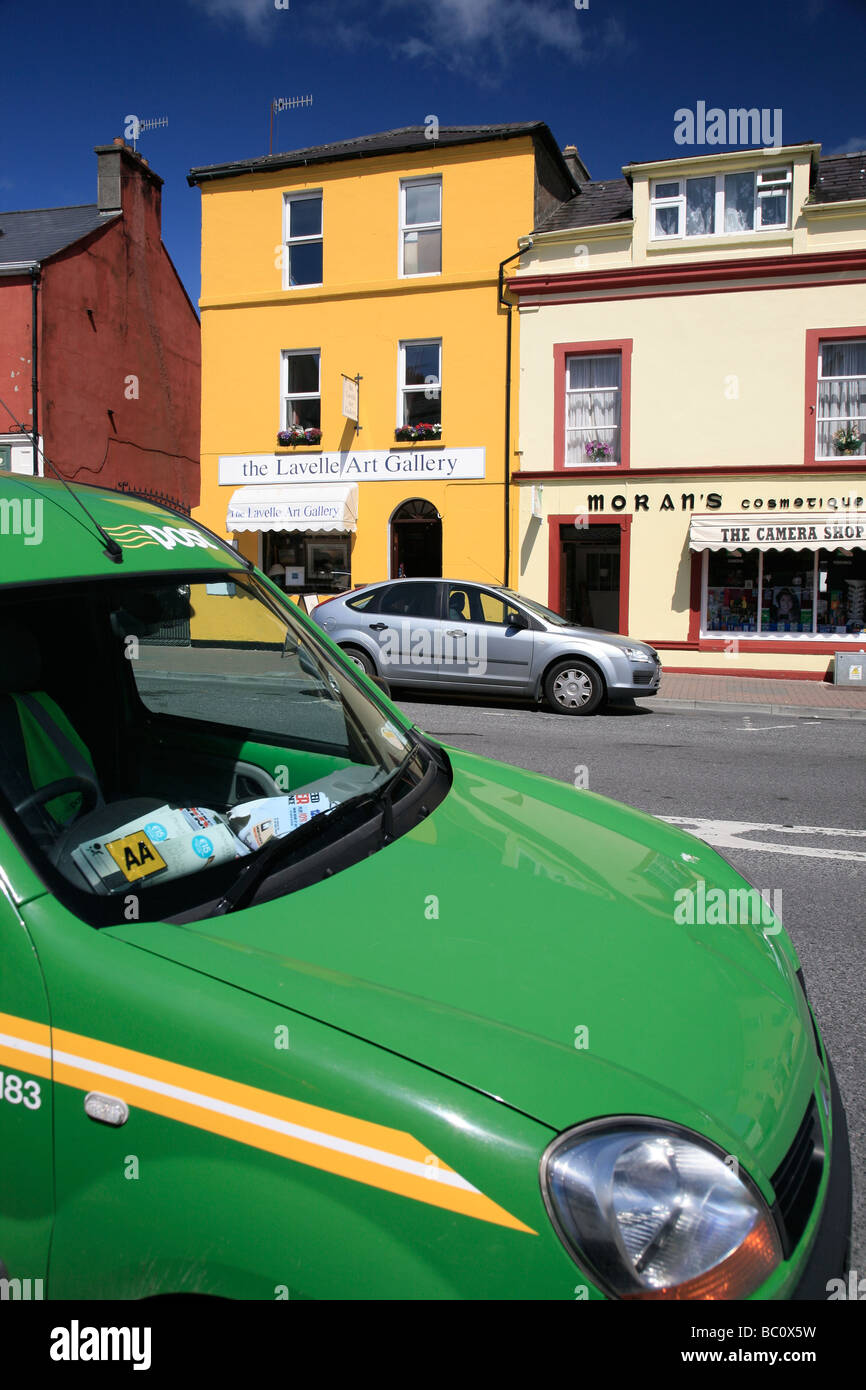 car of the Irish post in front of a yellow house, the art gallery in Clifden, Ireland - Stock Image
