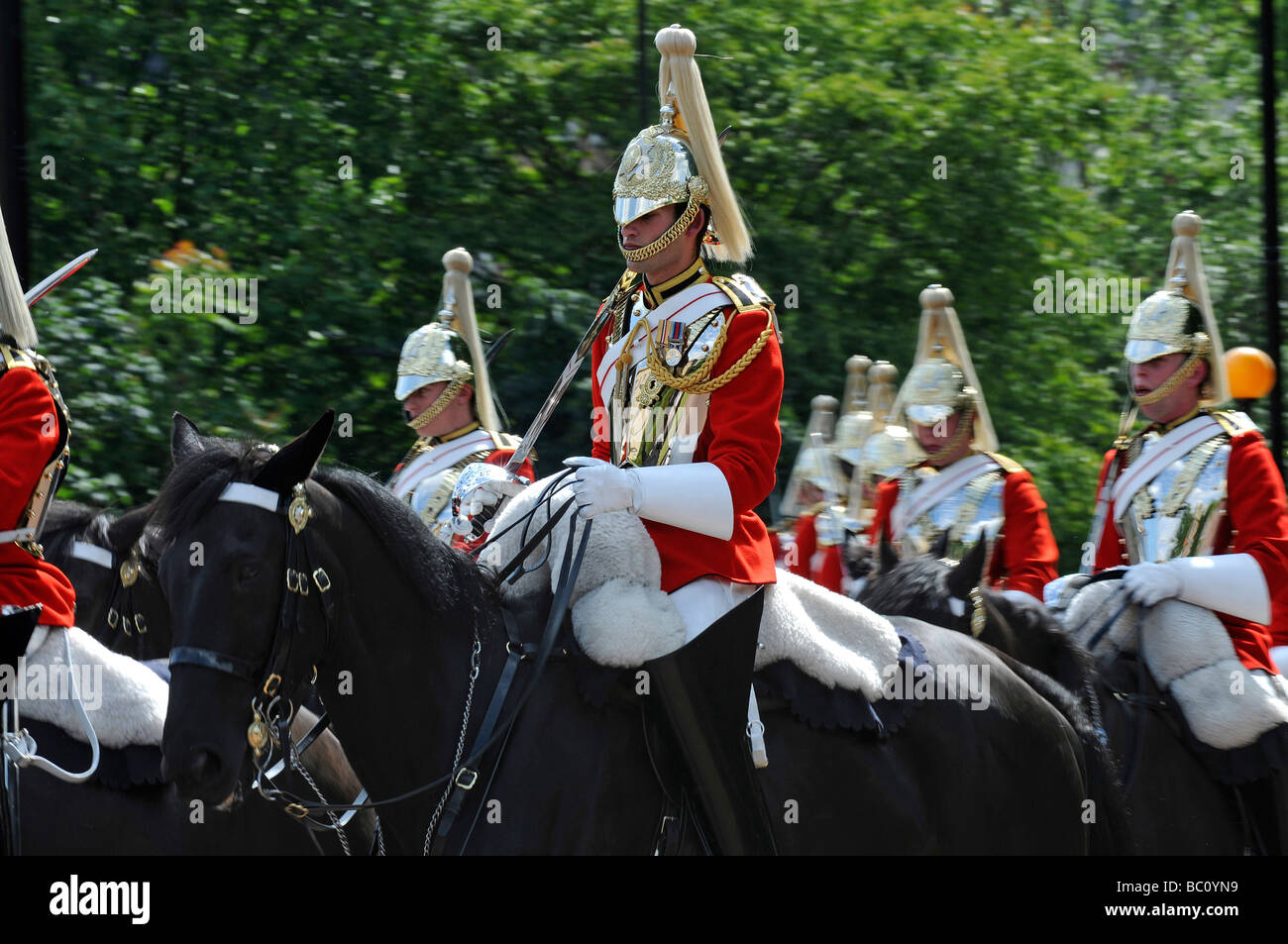 Horse Guards exiting Hyde Park in London - Stock Image