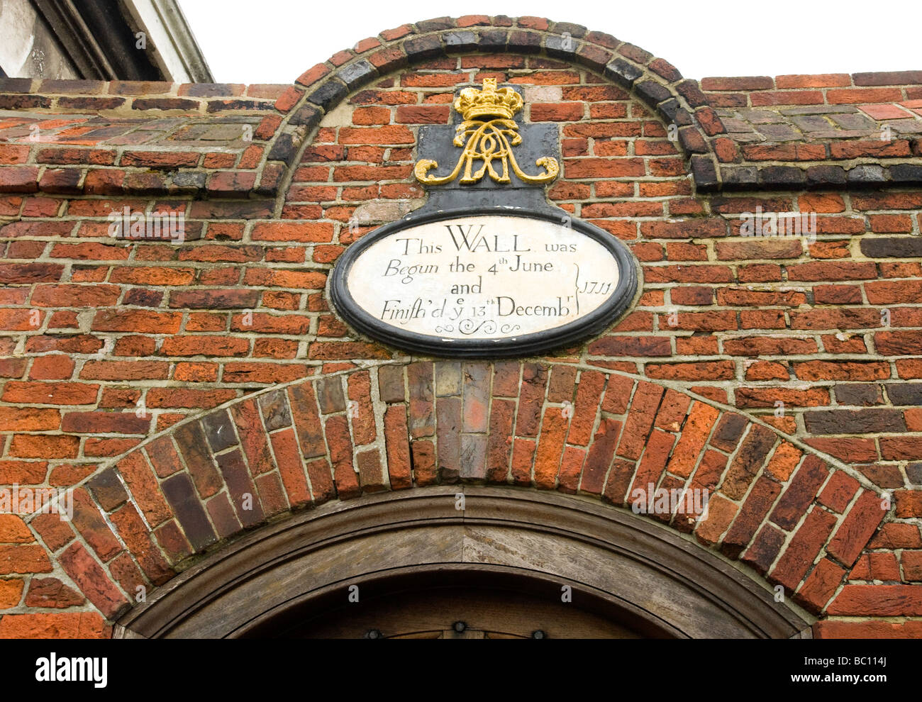 Sign on the wall near the entrance to Portsmouth Historic Dockyard, Portsmouth Harbour, Portsmouth, England, UK - Stock Image