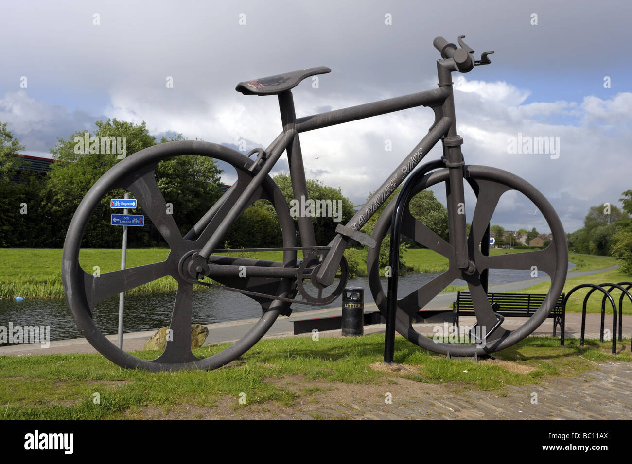 Giant bike sculpture at Clydebank, Glasgow, Scotland, on SUSTRANS cycling route 7 alongside Forth and Clyde Canal - Stock Image