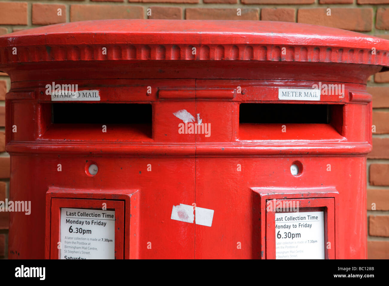 royal mail post box which has separate slots for stamped and metered mail oozells square birmingham uk - Stock Image
