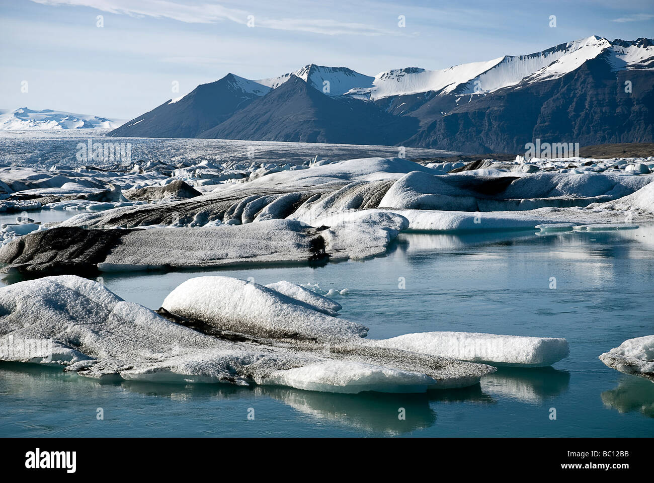 Icefloes floating in blue Jokulsarlon glacial lagoon in Iceland - Stock Image