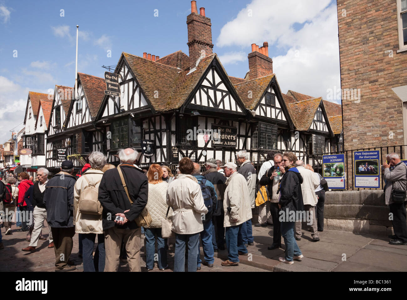 Canterbury Kent England UK Group of tourists by 16th century Old Weavers House timber framed building built 1500 - Stock Image