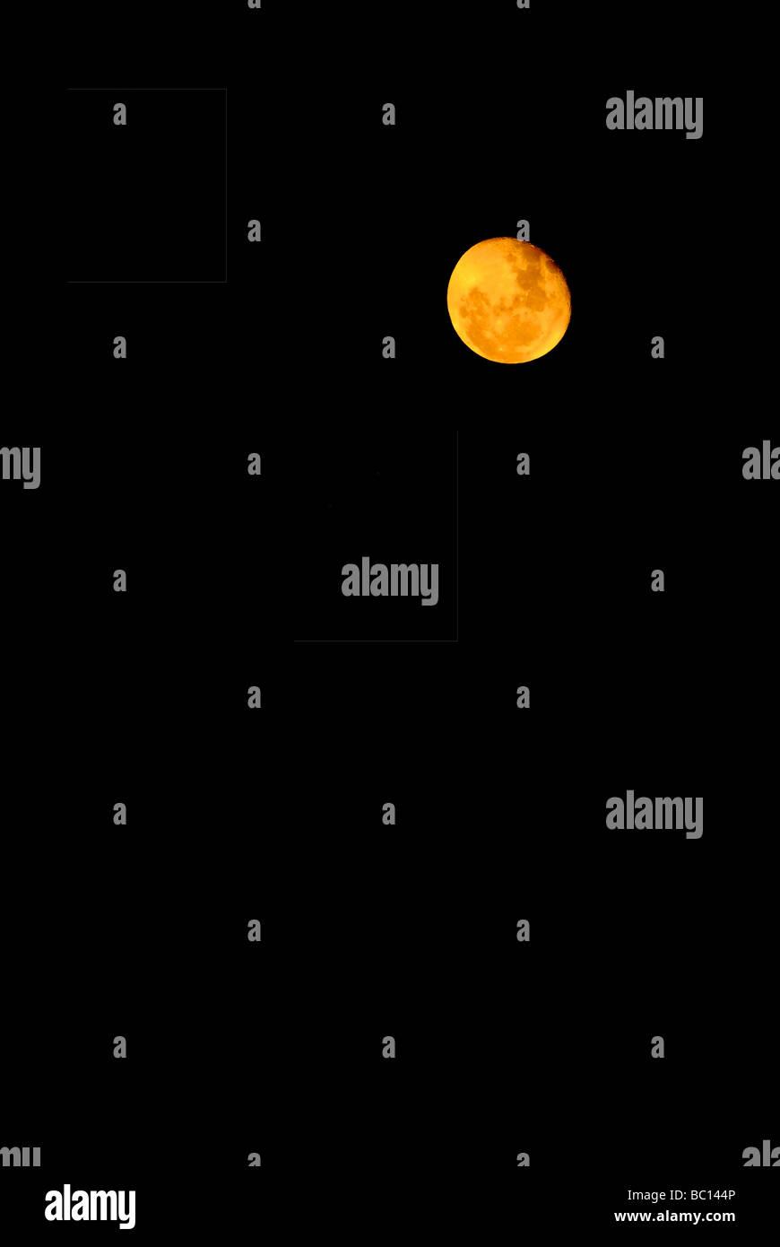 Orange moon on the black sky background - Stock Image