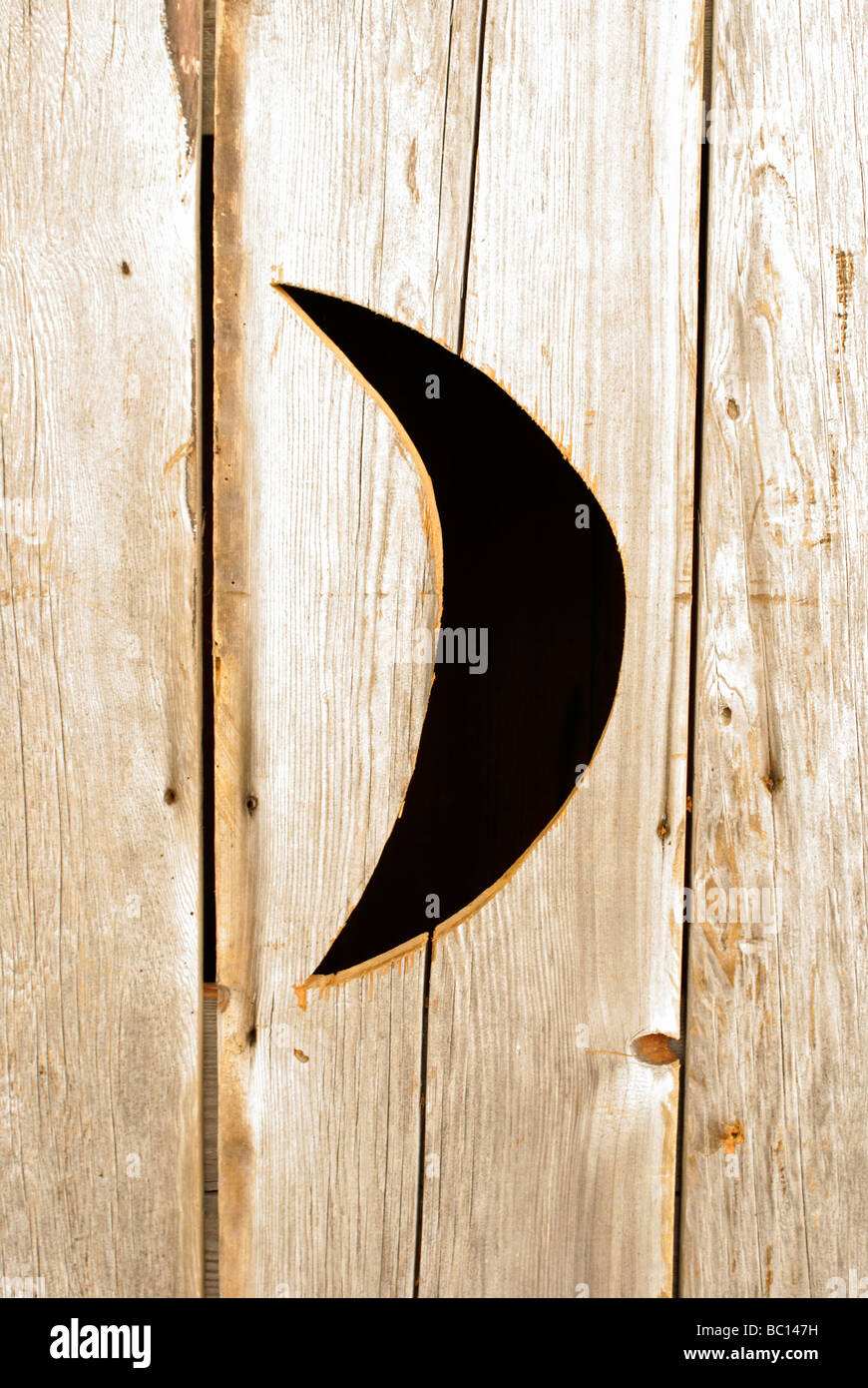 Half moon carved into door of old fashioned wooden outhouse & Half moon carved into door of old fashioned wooden outhouse Stock ...