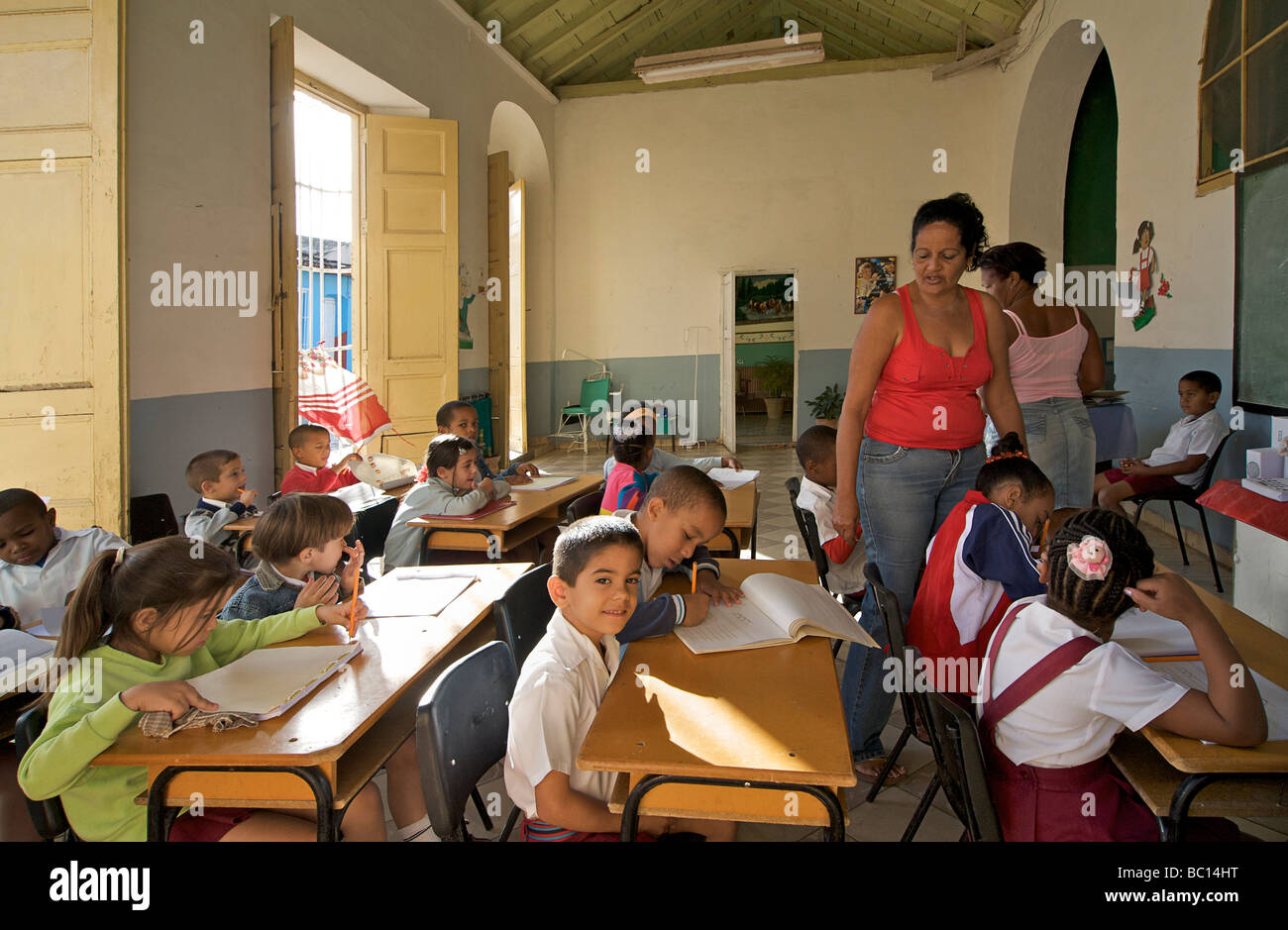 Primary school with children at their desks. Trinidad, Cuba - Stock Image