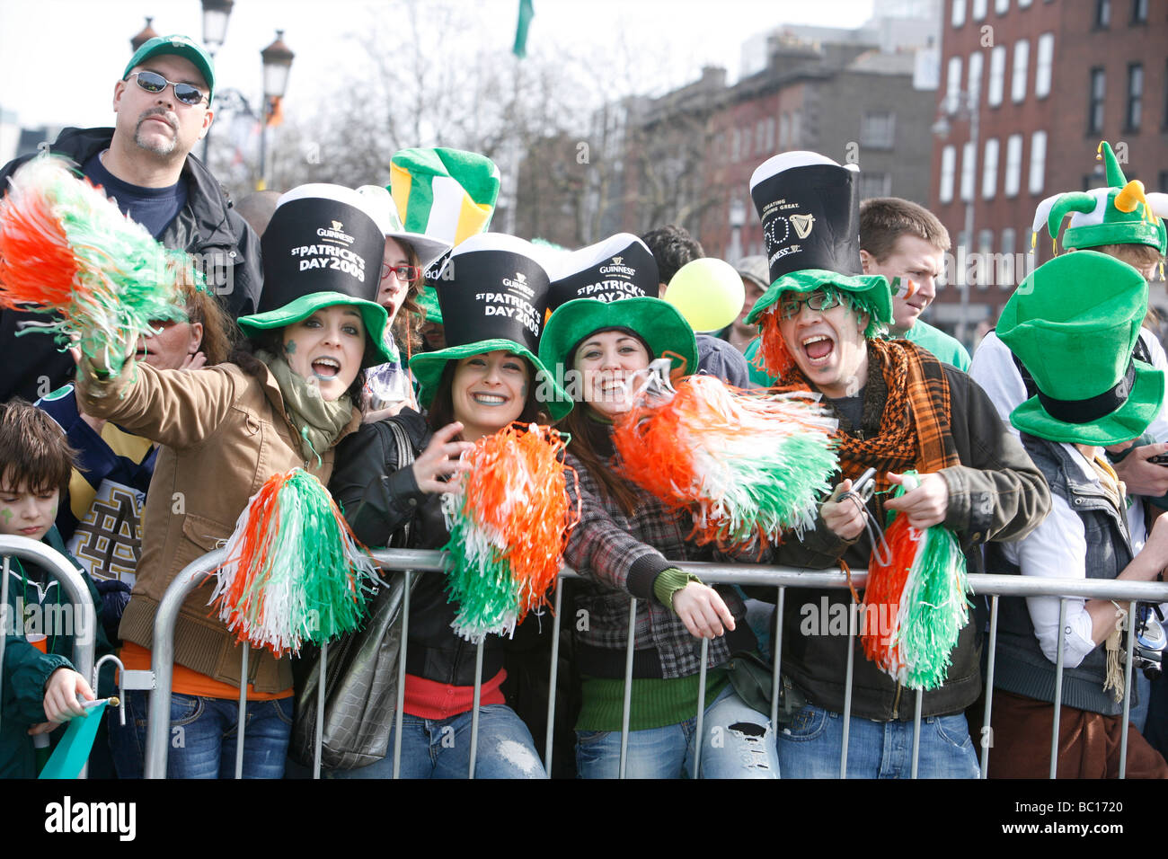 Onlookers at the St Patricks Day parade held every St Patricks Day (17th March) in Irish cities and all around the - Stock Image