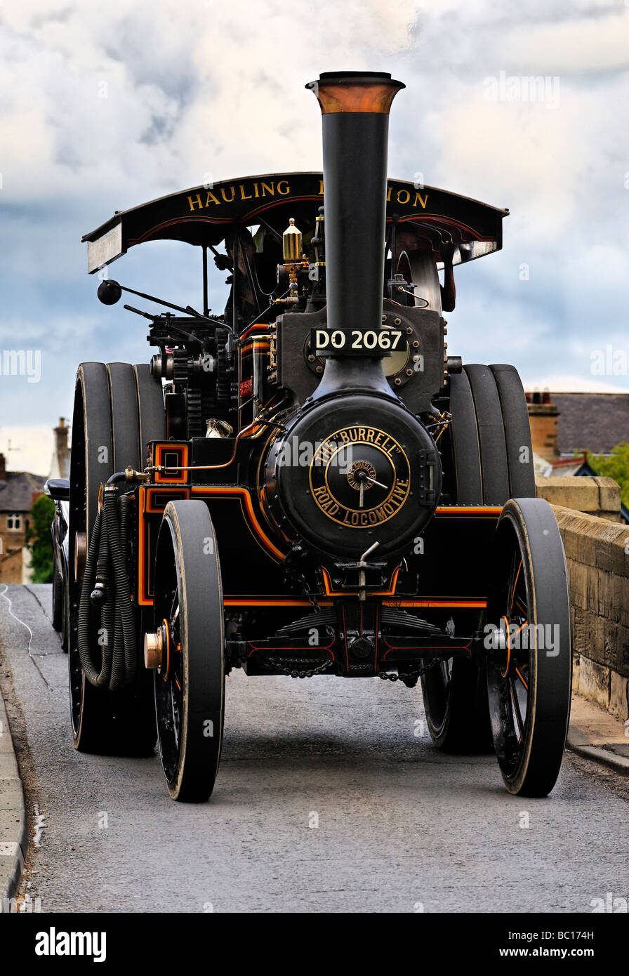 A traction engine heading for a Steam Rally in June 2009 crosses a narrow bridge over the River Tyne at Corbridge - Stock Image