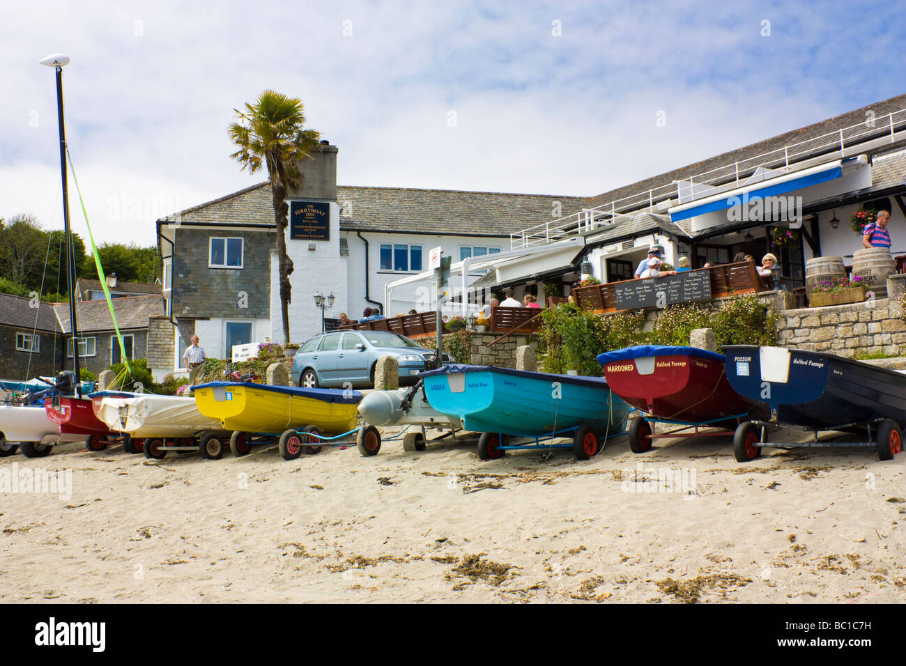 Boats infront of the Ferry Boat Inn Helford Passage Cornwall England UK - Stock Image